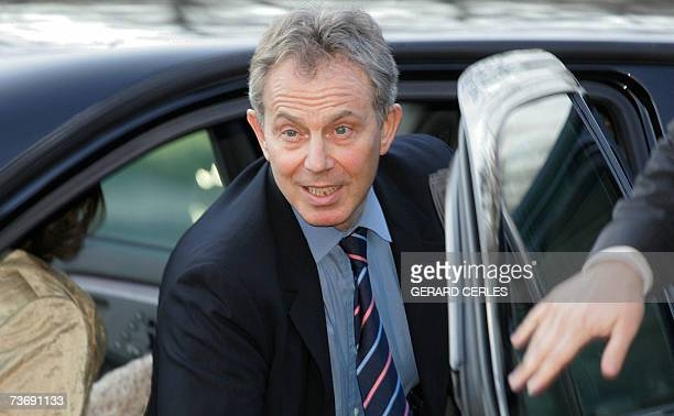 Britains Prime Minister Tony Blair gets out of his car as he arrives with his wife Cherie at the Philharmonic where they will attend an orchestra...