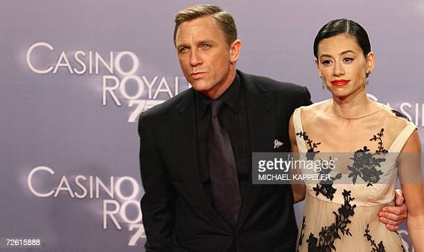 British actor Daniel Craig and his partner Satsuki Mitchell pose as they arrive for the German premiere of Craig's new film Casino Royale in Berlin...