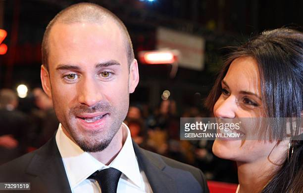British actor Joseph Fiennes and his partner Natalie Jackson Mendoza pose on the red carpet as they arrive for the premiere of the movie Goodbye...