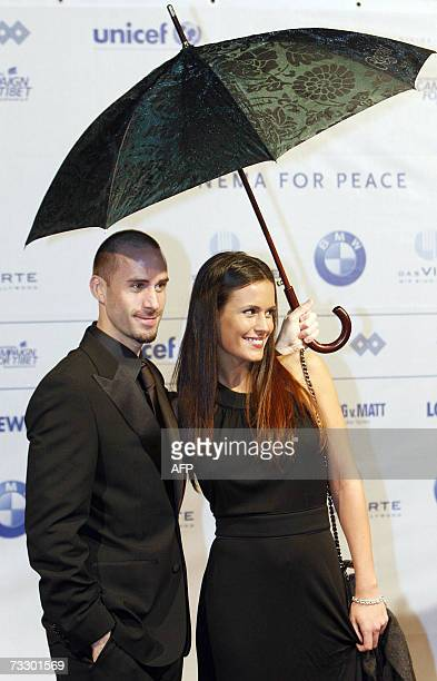 British actor Joseph Fiennes and his partner Natalie Jackson Mendoza pose for photographers as they attend the Cinema for Peace gala during the 57th...