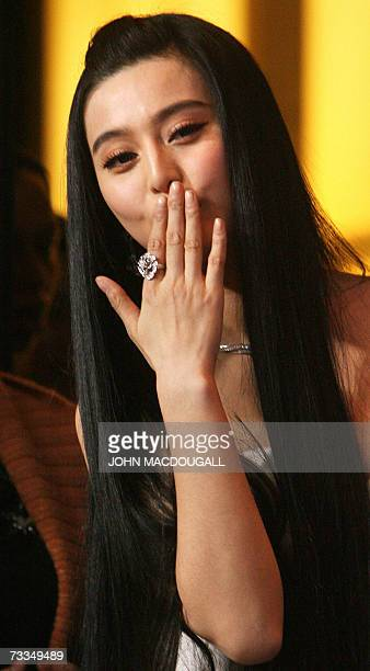 Chinese actress Fan BingBing blows a kiss to photographers after a photocall for the film Ping Guo Lost in Beijing by Chinese director Li Yu...