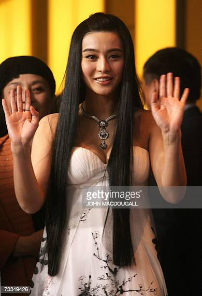 Chinese actress Fan BingBing waves to photographers after a photocall for the film Ping Guo Lost in Beijing by Chinese director Li Yu competing for...