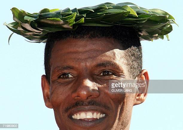 Ethiopian winner Haile Gebrselassie poses on the podium of the 33rd Berlin city marathon 24 September 2006 33yearold Gebrselassie double Olympic...