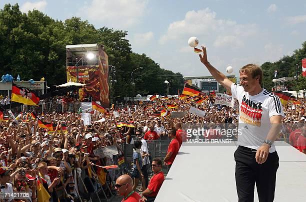 FILES Picture taken 09 July 2006 shows German head coach Juergen Klinsmann waving to supporters from the stage at the Fan Fest in Berlin Klinsmann...