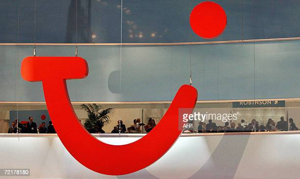 """Picture taken 09 March 2006 shows the logo of Europe's leading travel group TUI is seen at the company's booth on the """"Internationale Tourismus..."""