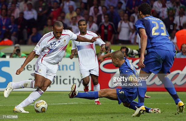 French forward Thierry Henry French midfielder Florent Malouda Italian defender Fabio Cannavaro and Italian defender Marco Materazzi fights for the...