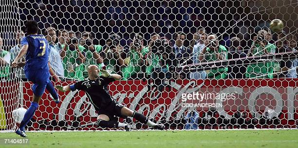 French goalkeeper Fabien Barthez tries to defend a penalty kick by Italian defender Fabio Grosso during their final football match between France and...