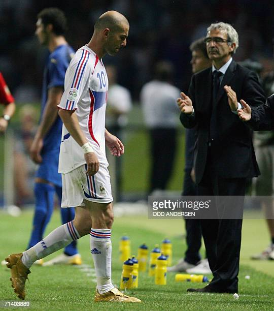 French head coach Raymond Domenech applauds as French midfielder Zinedine Zidane leaves the pitch after receiving a red card for headbutting Italian...