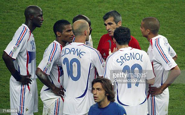French midfielder Zinedine Zidane and teammates argue with referee Horacio Elizondo of Argentina after Zidane received a red card for apparently...
