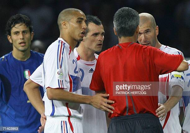 French midfielder Zinedine Zidane and teammates speak with referee Horacio Elizondo of Argentina after Zidane received a red card for apparently...