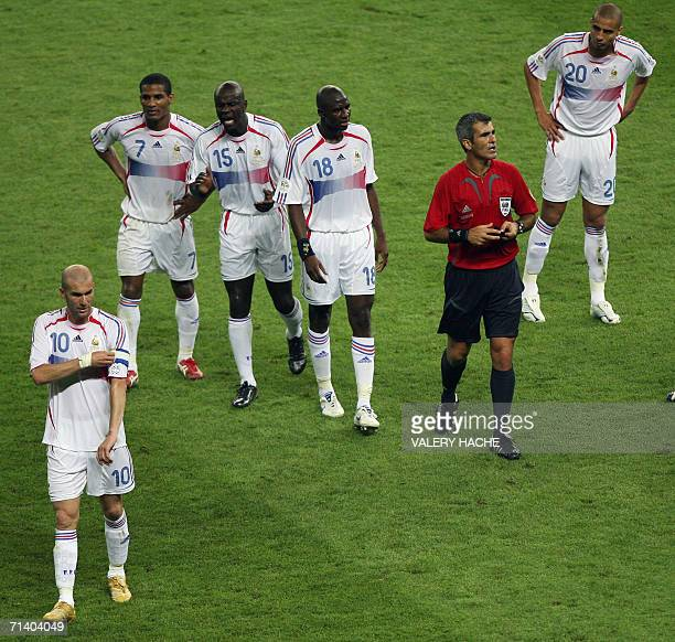French midfielder Zinedine Zidane begins to remove the captain's armband after receiving a red card from referee Horacio Elizondo of Argentina for...