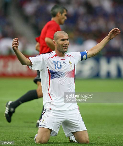 French midfielder Zinedine Zidane celebrates after scoring the first goal for his team during the World Cup 2006 final football game Italy vs.France,...