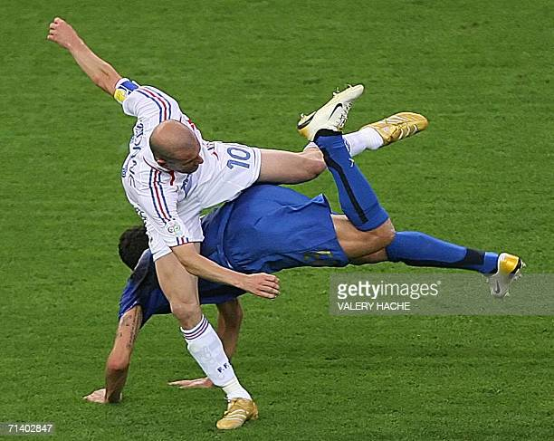 French midfielder Zinedine Zidane fights for the ball with Italian defender Marco Materazzi during the World Cup 2006 final football match between...