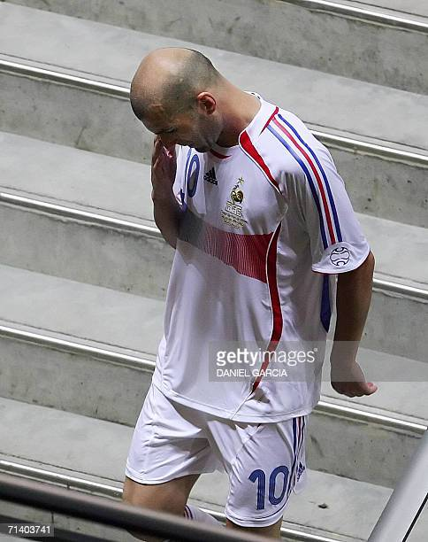 French midfielder Zinedine Zidane goes down into the tunnel after receiving a red card for headbutting Italian defender Marco Materazzi during the...