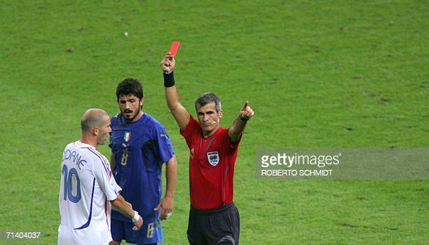 French midfielder Zinedine Zidane receives a red card from referee Horacio Elizondo of Argentina for apparently head-butting Italian defender Marco...