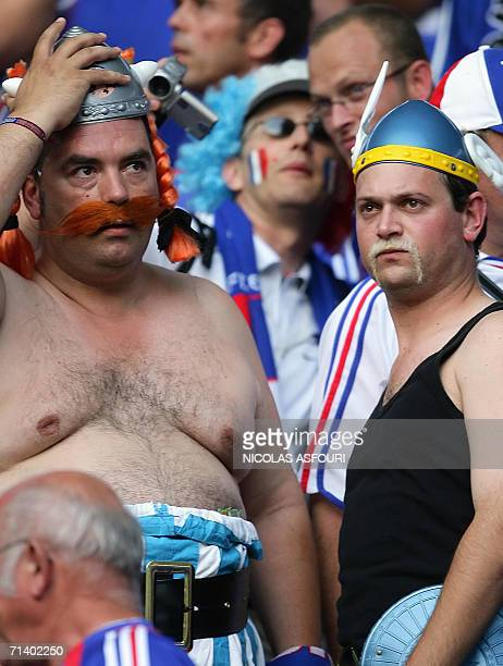 French supporters disguised in Asterix and Obelix are seen ahead of the World Cup 2006 final football match between Italy and France at Berlins...