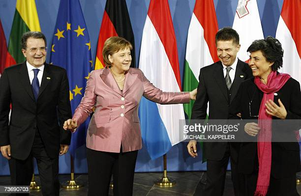 German Chancellor Angela Merkel and her husband Joachim Sauer welcomes Italian Prime Minister Romano Prodi and his wife Flavia Franzoni before the...