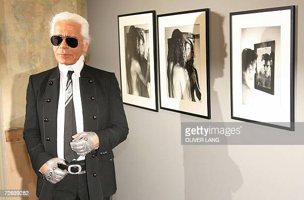 German fashion designer and photographer Karl Lagerfeld poses in front of some of his photographs 24 November 2006 at the C/OCultural Forum for...