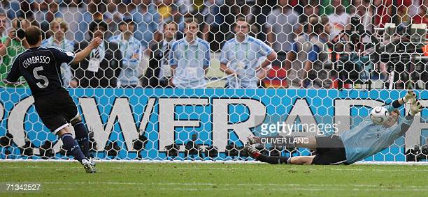 German goalkeeper Jens Lehmann dives to save a penalty kick by Argentinian midfielder Esteban Cambiasso to win the game during a penalty shootout at...