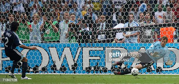 German goalkeeper Jens Lehmann stops a penalty kick by Argentinian defender Roberto Ayala at the end of the quarterfinal World Cup football match...