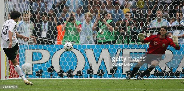 German midfielder Michael Ballack scores against Argentinian goalkeeper Leonardo Franco during a penalty shootout at the end of the quarter-final...