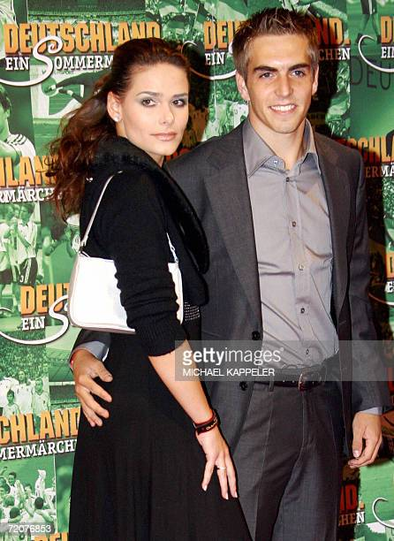 German national football team defender Philipp Lahm and his girlfriend Nicola pose prior to attend the premiere of Soenke Wortmann's movie...