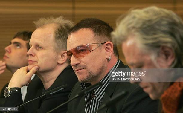 German pop star Herbert Groenemeyer Irish pop band U2 frontman Bono and Irish political activist Bob Geldof address a press conference following the...