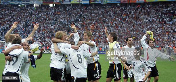 German teammates celebrate following their victory in a penalty shootout at the end of the quarterfinal World Cup football match between Germany and...