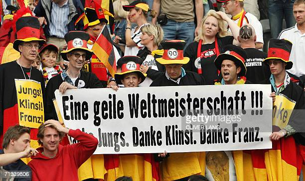 Germany supporters hold up a sign reading 'A fucking great WC2006 Thanks boys Thanks Klinsmann Thanks Franz ' as they wait for the start of the...