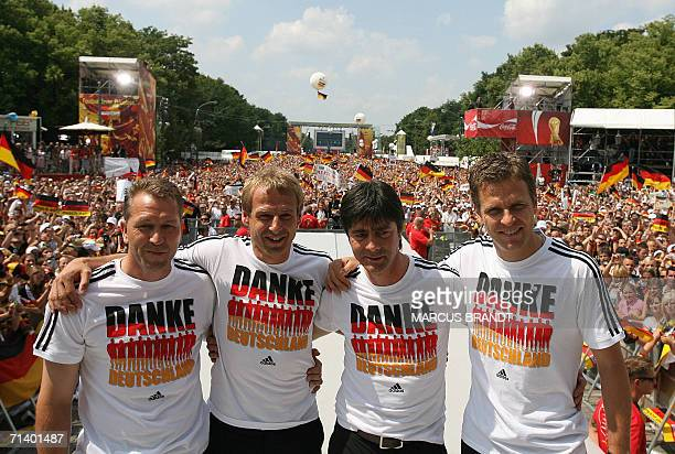 Germany's goalkeeper's trainer Andreas Koepke head coach Juergen Klinsmann assistant coach Joachim Loew and team manager Oliver Bierhoff pose as the...