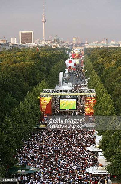 Hundreds of supporters of the German national football team watch the broadcast of the match on giant screens at the Fan Fest 08 July 2006 in Berlin...