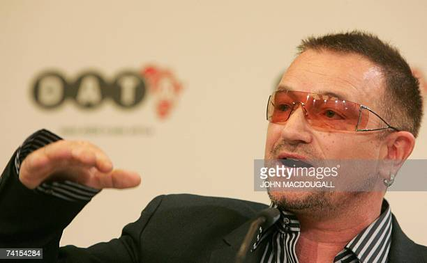 Irish pop band U2 frontman Bono gestures as he addresses a press conference following the release of the DATA report 2007 15 May 2007 in Berlin Bono...