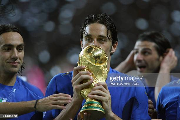 Italian defender Alessandro Nesta, Italian forward Luca Toni and Italian forward Vincenzo Iaquinta celebrate with the trophy after the World Cup 2006...