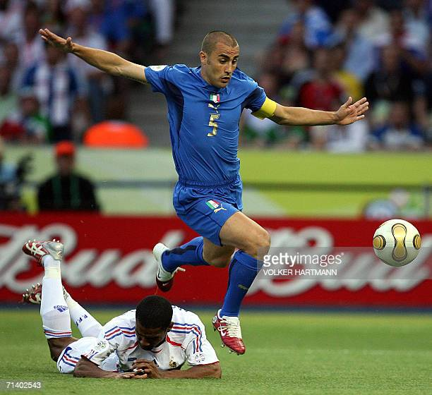 Italian defender Fabio Cannavaro fights for the ball with French defender Eric Abidal during the World Cup 2006 final football game Italy vsFrance 09...