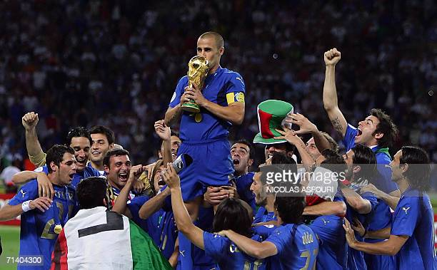 Italian defender Fabio Cannavaro kisses the trophy after the World Cup 2006 final football game Italy vsFrance 09 July 2006 at Berlin stadium Italy...