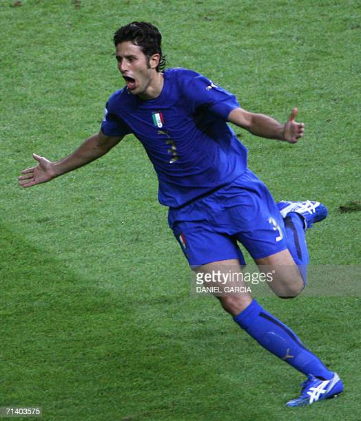 Italian defender Fabio Grosso celebrates after scoring the winning penalty for his team during the World Cup 2006 final football match between Italy...