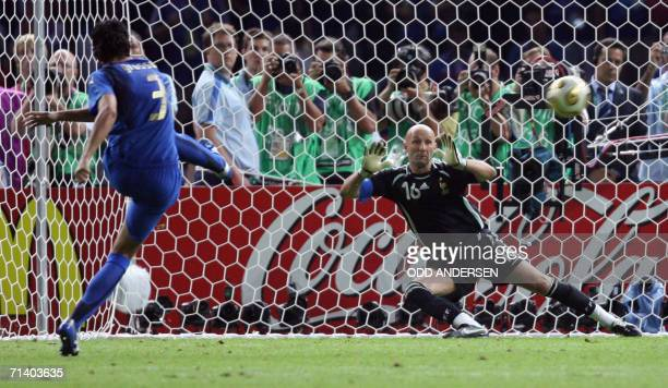 Italian defender Fabio Grosso shoots the winning penalty against French goalkeeper Fabien Barthez during the World Cup 2006 final football game Italy...