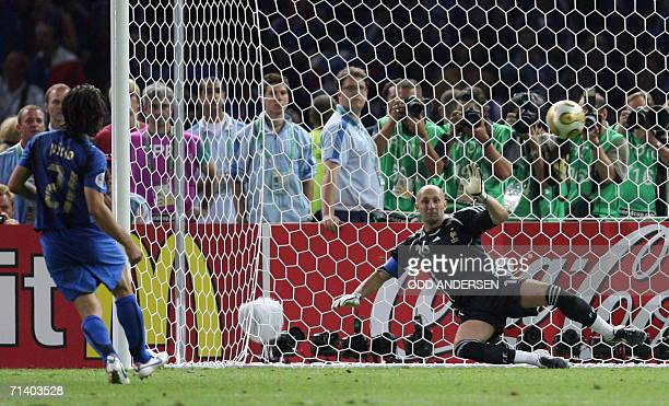 Italian midfielder Andrea Pirlo scores a goal from a penalty kick during the World Cup 2006 final football match between Italy and France at Berlins...