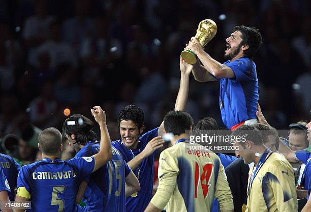 Italian midfielder Gennaro Gattuso celebrates with the trophy after the World Cup 2006 final football game Italy vs.France, 09 July 2006 at Berlin...