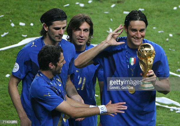 Italian midfielder Simone Perrotta Italian forward Vincenzo Iaquinta Italian midfielder Andrea Pirlo and Italian forward Luca Toni celebrate with the...