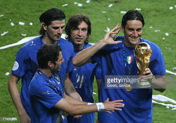 Italian midfielder Simone Perrotta Italian forward Vincenzo Iaquinta Italian midfielder Andrea Pirlo and Italian forward Luca Toni celebrate with the...
