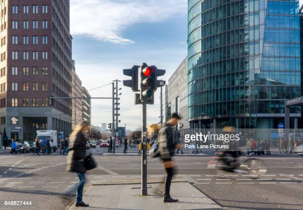 Berlin, Germany, many pedestrians crossing street on Potsdamer Platz, Berlin, Germany