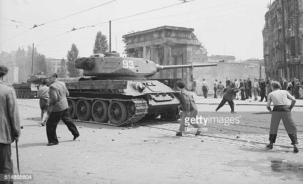 6/10/1973 Berlin Germany Men against tanks A Russian tank is attacked by stonethrowing East Berliners during the shortlived uprising by workers that...