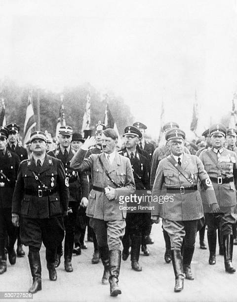 Nazi officials marching at demonstration in Berlin Chief of Staff Roelm who was arrested by Hitler and ordered to be executed Hitler in the familiar...