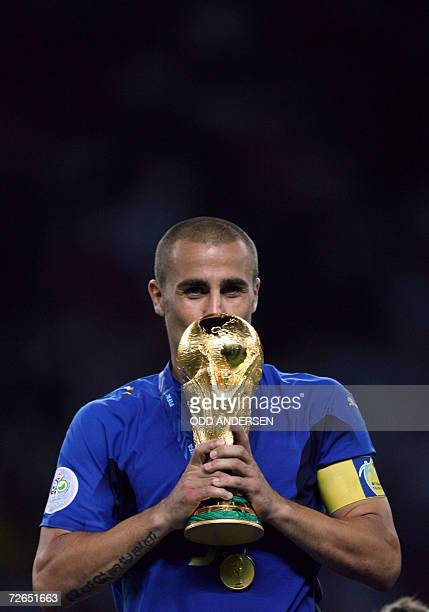 - Picture taken 09 July 2006 of Italian defender Fabio Cannavaro kissing the trophy after the World Cup 2006 final football game Italy vs.France at...