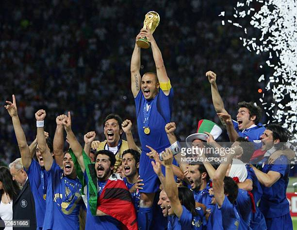 Picture taken 09 July 2006 of Italian defender Fabio Cannavaro celebrating with the trophy after the World Cup 2006 final football game Italy...