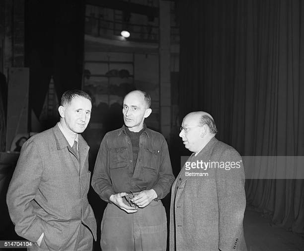 Playwright Bert Brecht and Hans Eisler musician who was ejected from the US for Communist leanings chat with unidentified electricians at Culture...