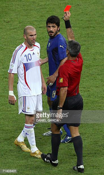 Referee Horacio Elizondo of Argentina issues a red card to French midfielder Zinedine Zidane after he committed a penalty in extra time during the...