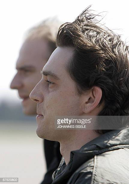 Released German engineers Rene Braeunlich and Thomas Nitzschke speak to reporters as they arrive at Berlin's Tegel airport 03 May 2006 after they...