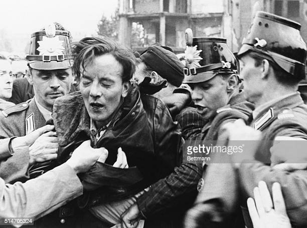 6/19/1953 Berlin Germany Shot in East Berlin riot The first victim of a police bullet in the June 17 East Berlin riot of workers is helped from the...